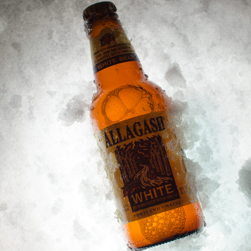 beer backlit on snow