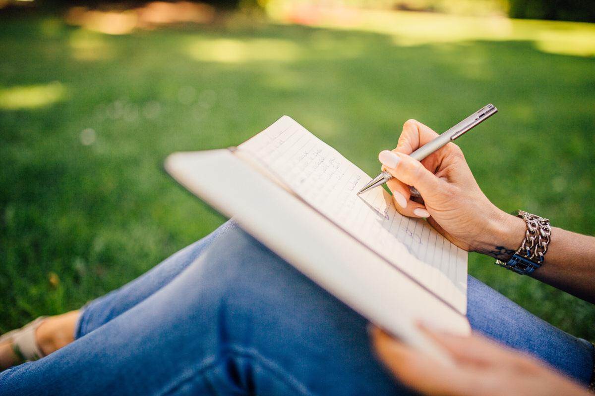 person, pencil, writing, notepad, sitting