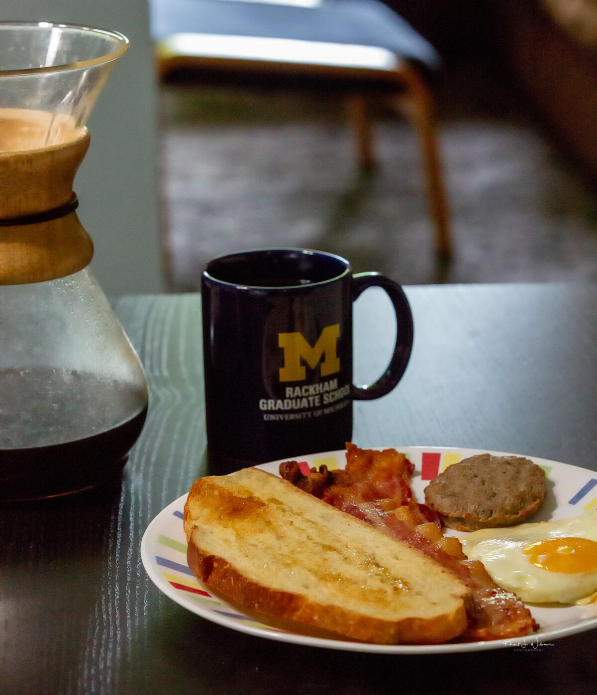 Oven backed bacon, oven fried egg, turkey sausage patty, semolina toast with drizzled honey, and fresh coffee brewed in the Chemex