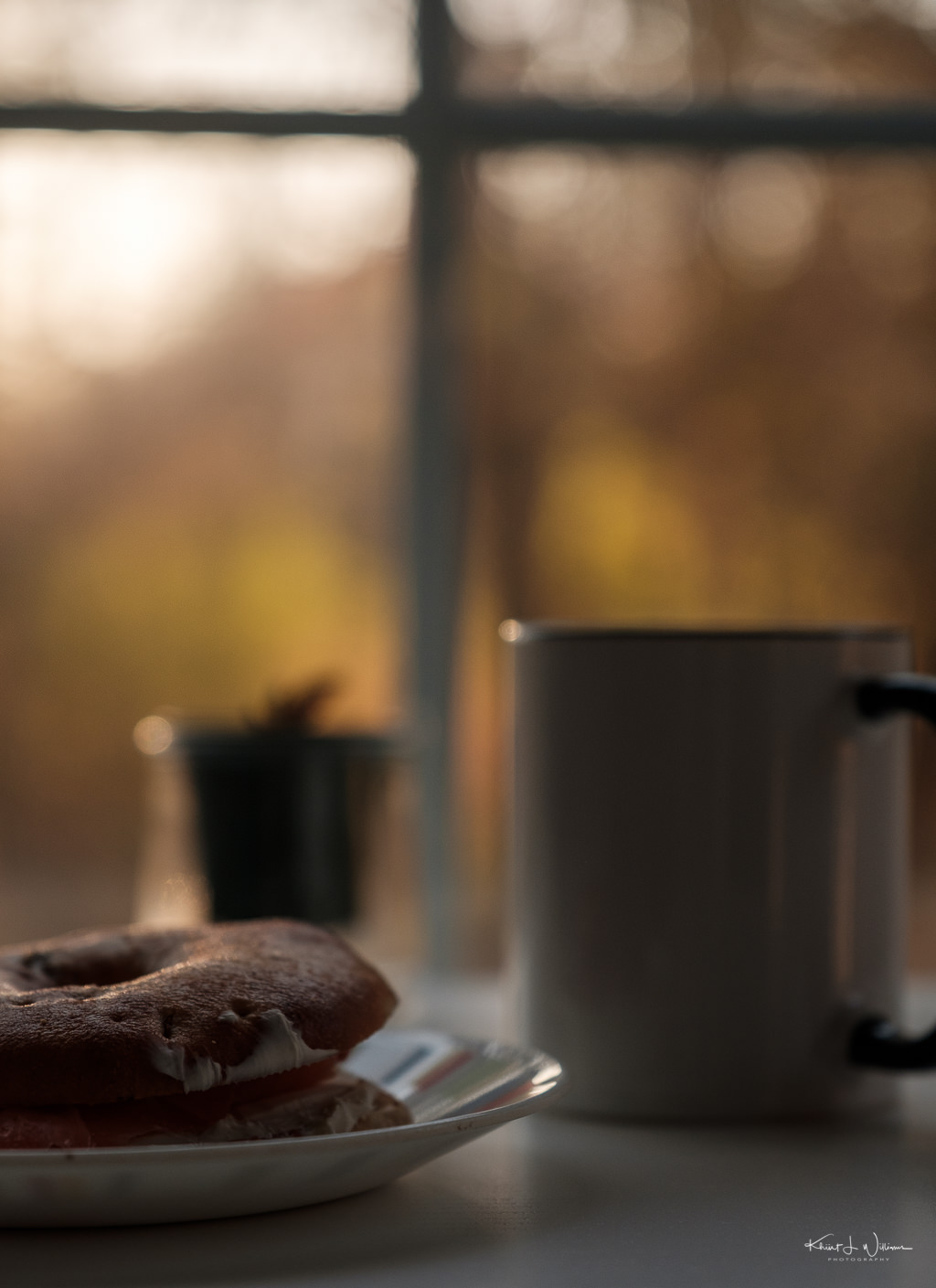 bagel, coffee mug, low morning light