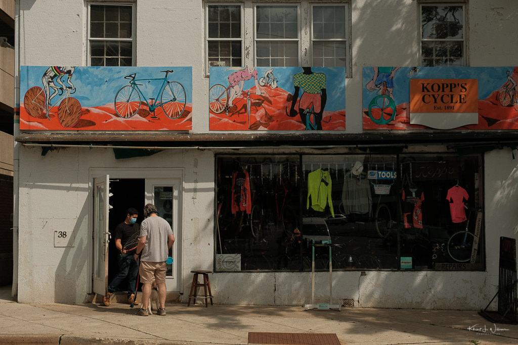man outside Kopp's bicycle shop on Spring Street