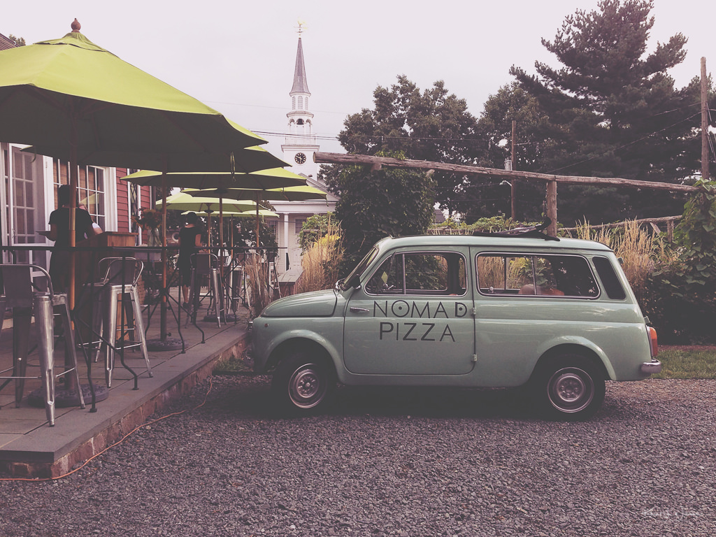 """nomad pizza car parked outside nomad pizza"""""""