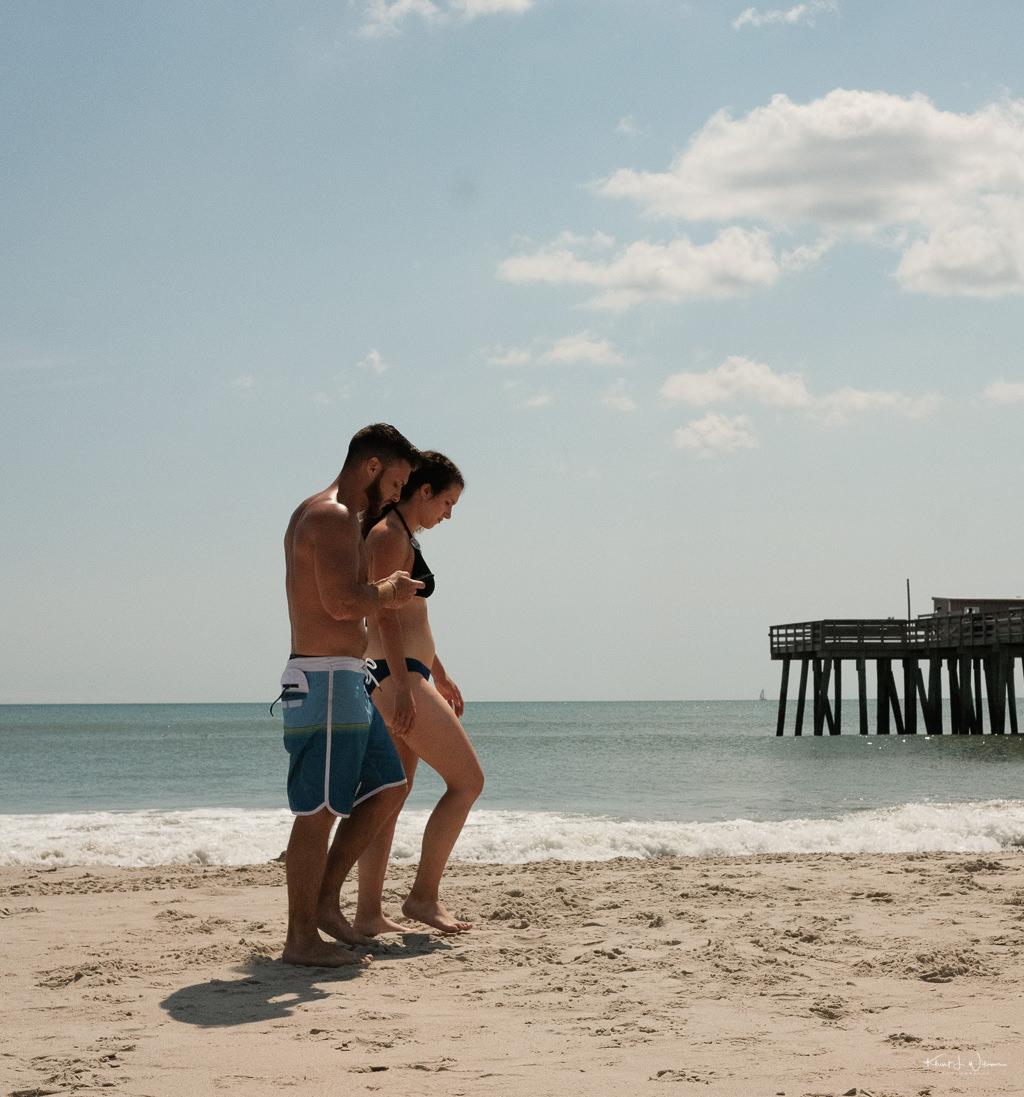 Couple walking Beach Scene