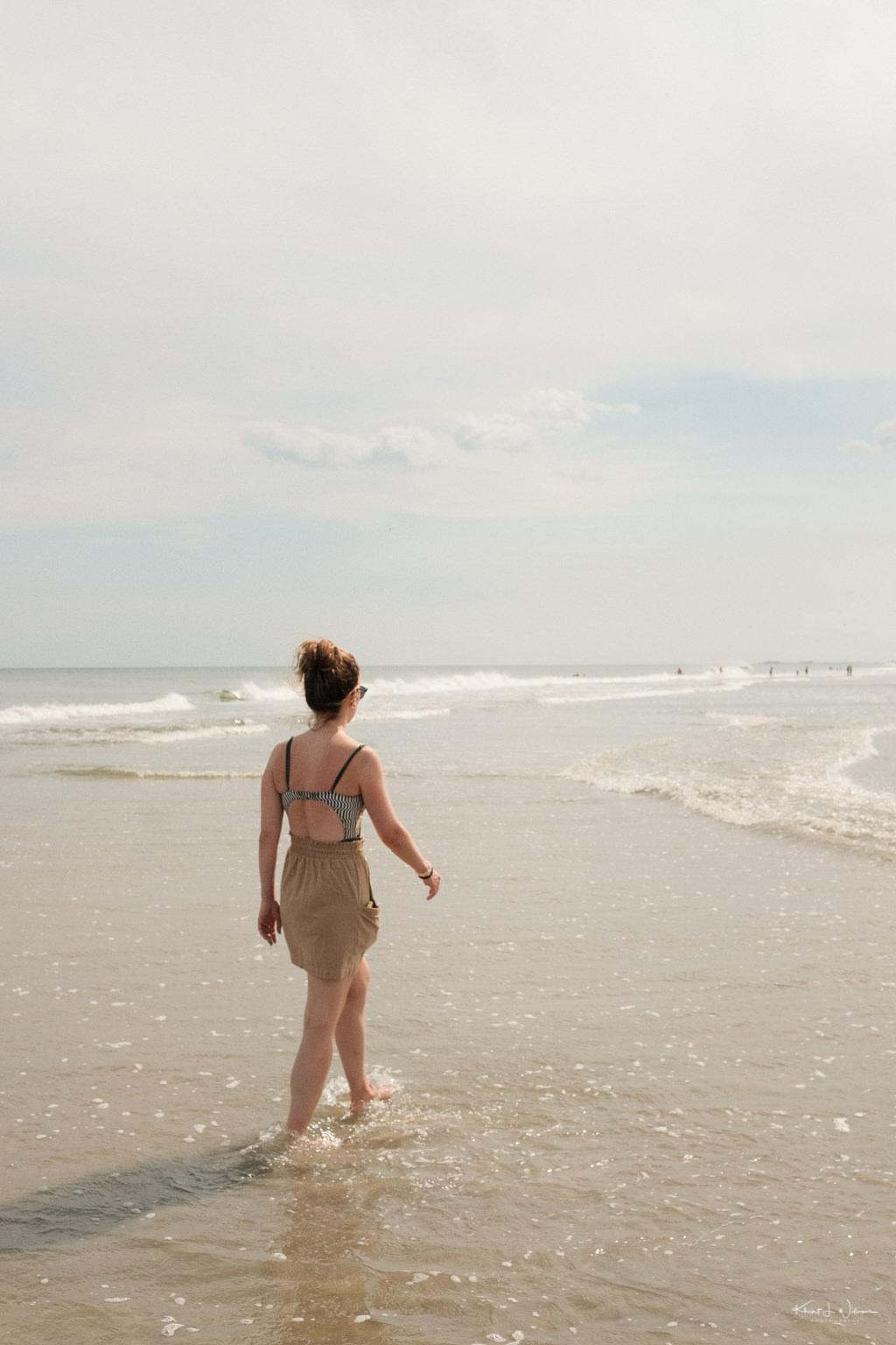 Woman Walking Beach Scene