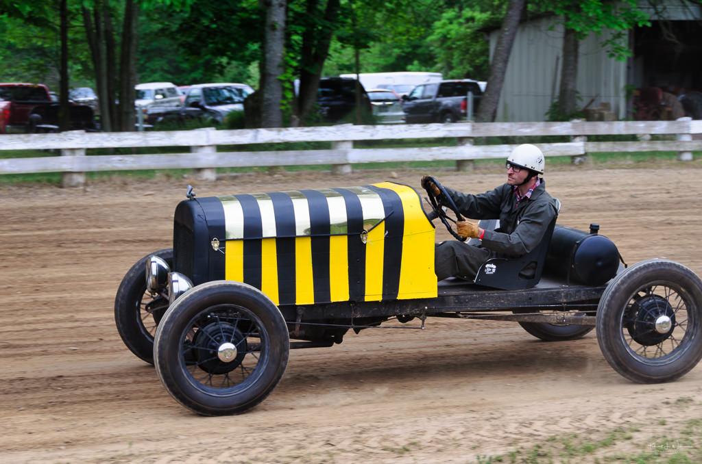 man racing jalopy