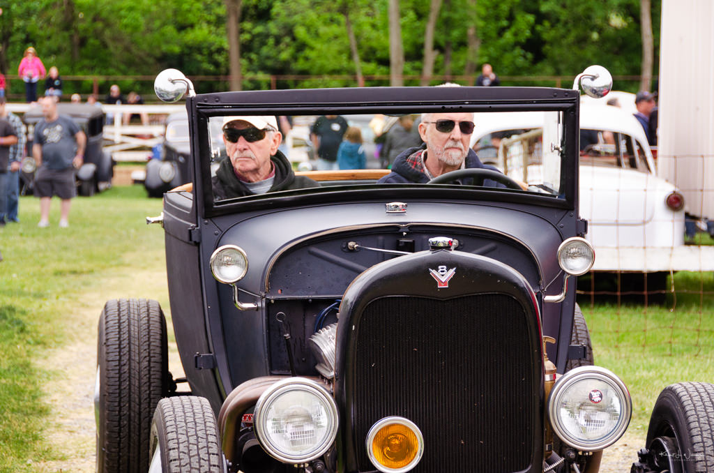 two men in jalopy